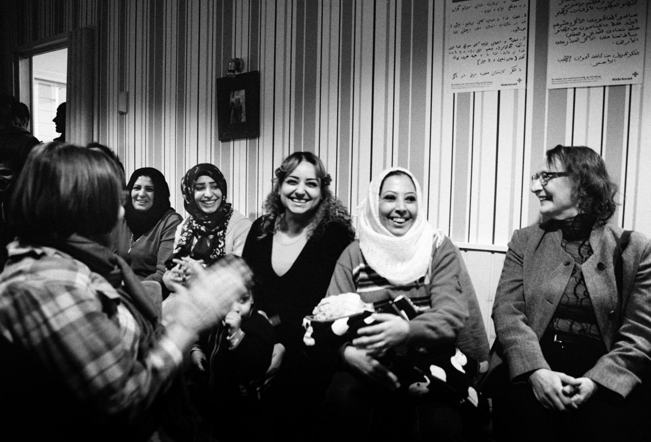 volunteers from Nagu and refugees laugh together during a New Year's Eve concert put on by local musicians. Hardly a day goes by without an activity that brings the locals and the guests' together. After the concert, the Afghan families asked if they could sing a traditional song, the sadness in their voices left the room in tears.